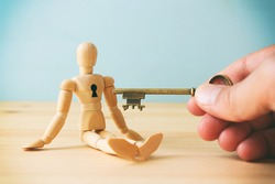 concept of unlock your potential. person hand with key to dicover new talents and achievements