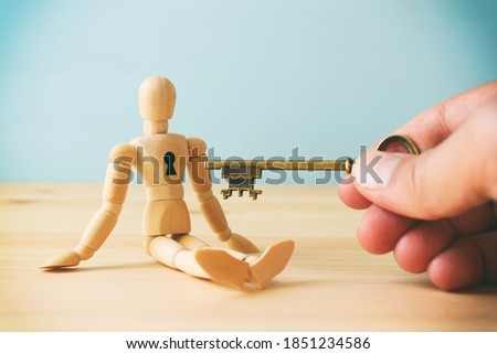 concept of unlock your potential. person hand with key to dicover new talents and achievements Stockfoto ©