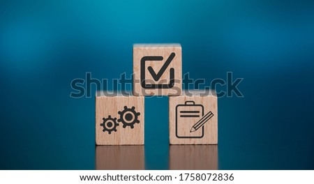 Concept of validation with icons on wooden cubes Photo stock ©