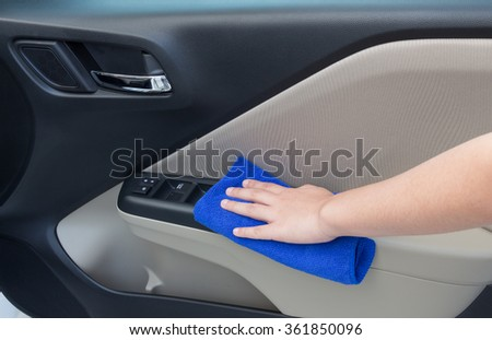 Concept Of Woman Hand Cleaning Interior Car Door Panel With