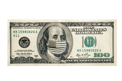 Concept, one hundred dollars with Benjamin Franklin masked by a virus. Coronavirus protection.