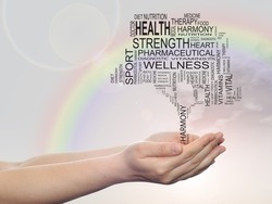 Concept or conceptual black text word cloud as tree in man or woman hand on rainbow sky  background, metaphor to health, nutrition, diet, wellness, body, energy, medical, sport, heart or science