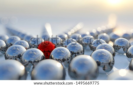 Concept or conceptual collection of balls with a red one standing out on blue background as a metaphor for creativity, leadership and independence. A courage, action and success 3d illustration