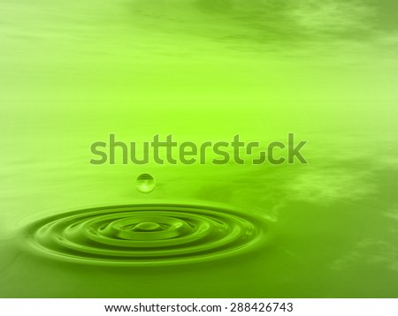 Concept or conceptual green liquid drop falling in water with ripples and waves background as metaphor to nature, natural, summer, spa, drink, cool, business, environment, rain or health design