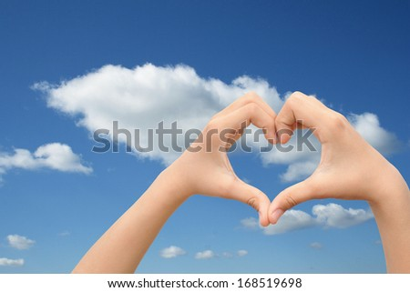 Concept or conceptual human male or man and woman hands in love, Valentines shape or symbol of heart over blue sky background,metaphor to romance,romantic,wedding,honeymoon,holiday,vacation or couple - stock photo
