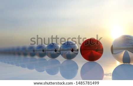 Concept or conceptual row of balls with a red one standing out on blue background as a metaphor for creativity, personality and independence A leadership, courage and action or success 3d illustration