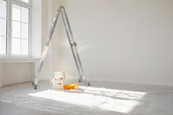 Concept painting work repair painting. Ladder paint cans in a white room for repair