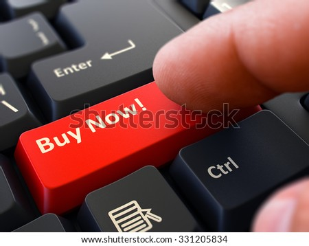 Concept. Person Click on Red Keyboard Button with Text Buy Now. Selective Focus. Closeup View.