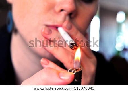 Concept photo of a woman smoking a cigarette.