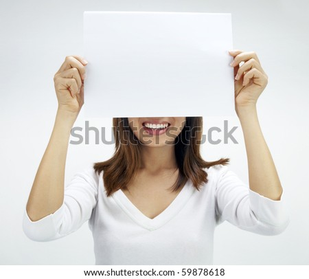 Concept photo of Asian woman holding a white card, covering her eyes.