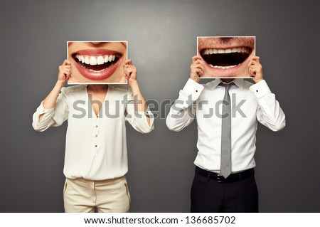 concept photo of laughing merrily couple over dark background