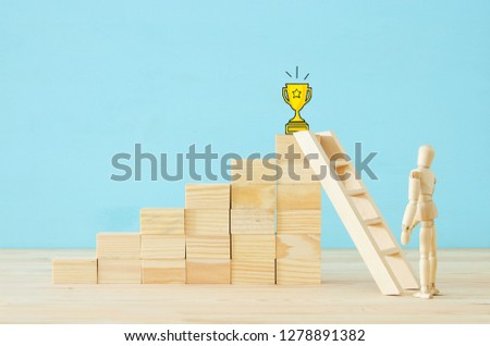 concept photo of obstacles overcoming, wooden dummy looking at a barrier and thinking about solution #1278891382