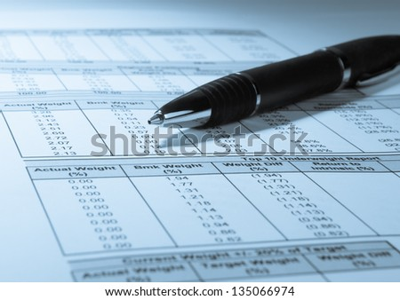 Concept photo showing a pen and financial numbers on a printout