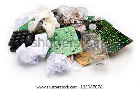 Concept photo showing digital computer parts discarded in garbage pile