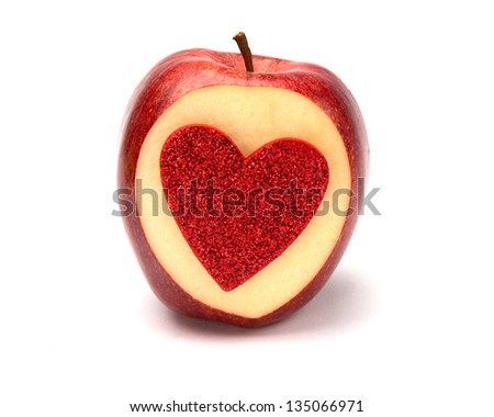 Concept photo with cut apple and heart in it