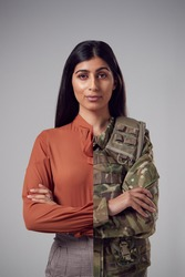 Concept Portrait Of Woman Showing Contrasting Day And Night Job Roles In Business And As Soldier