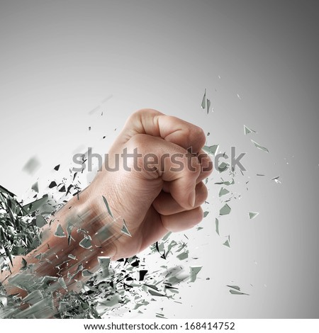 concept. power fist coming out of cracked glass High resolution