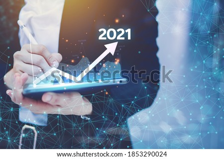 Concept presenting the technology business Graph of revenue generated by laptops, process overview, total enterprise average for the year 2021
