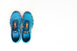 Concept run. Concept love run. Pair of trendy blue running shoes for men on a white background. Top view.