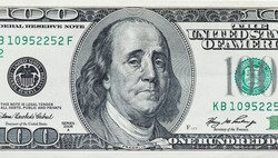 Concept showing devaluation of american dollars by Quantitative easing programme - crying Benjamin Franklin