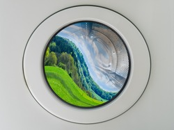 Concept symbol image greenwashing washing machine with deformed beautiful landscape inside