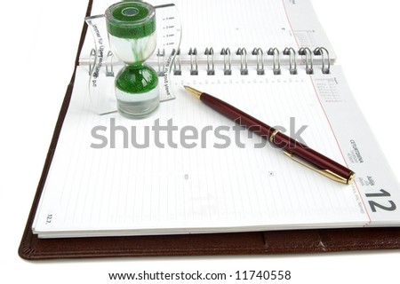 Concept time management, isolated diary, clock and pen on a white background