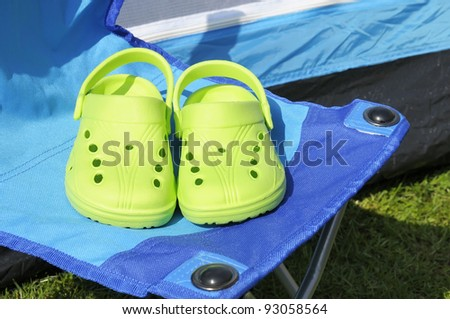 Concept to illustrate a reduction in carbon footprint by going on camping holidays.