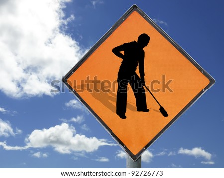 Concept to illustrate 'Women at work'. Humourous play on the 'Men at work' sign isolated with clipping path(s) against a blue sky.