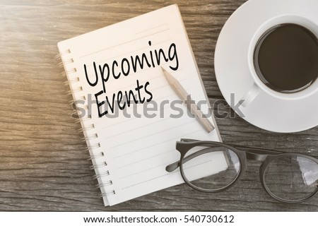 Concept Upcoming Events message on notebook with glasses, pencil and coffee cup on wooden table. #540730612