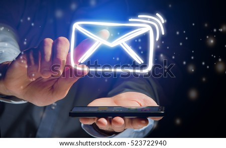 Concept view of sending message with smartphone with email icon around #523722940
