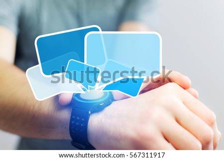 Concept view of sending messages with a smartwatch #567311917