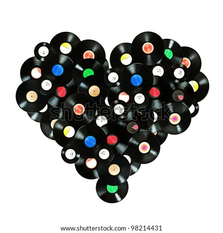 "Concept ""We love music"" colorful heart shape made of vintage vinyl records, isolated over white background, all labels designed by myself"