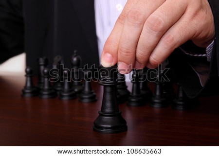 concept with businessman playing chess