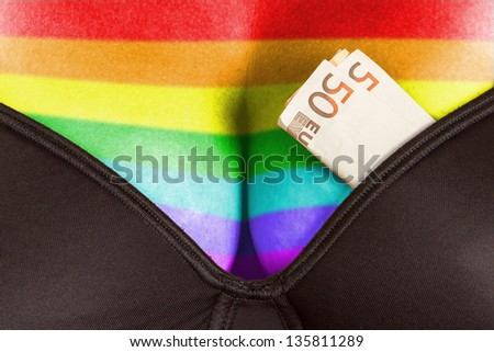 Concept - woman with cash in a bra (50 euro), rainbow flag pattern