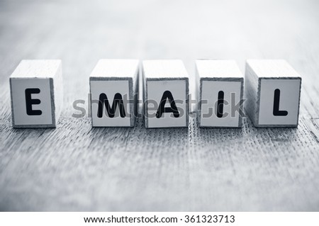 Concept Word Forming With Cube On Wooden Desk Background E Mail