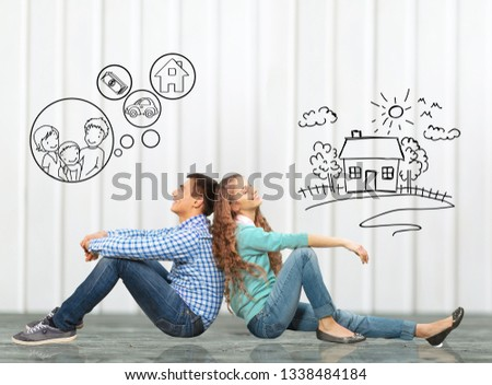 concept. young happy family couple dreaming of new house, car, child, financial well-being #1338484184