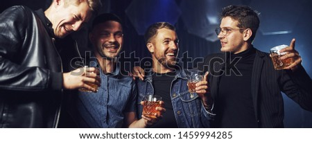 Conception of nightlife. People have fun in the club. With alcohol in hands. #1459994285