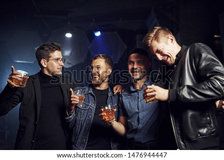 Conception of nightlife. People have fun in the club. With alcohol in hands. #1476944447