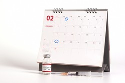 Concepts of coronavirus vaccine two doses injection. Injection at first week and third week for covid-19 antibody protection. Vaccine bottle, syringe, calendar on white background