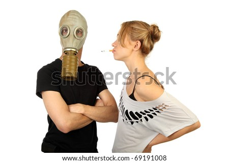 Conceptual a photo, the woman smokes on against the man in a gas mask .isolated over white