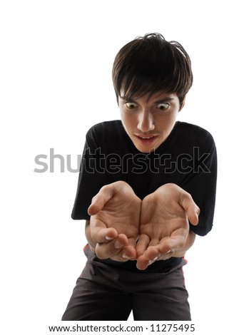 Conceptual astonished young man holding nothing on his hands, isolated on white