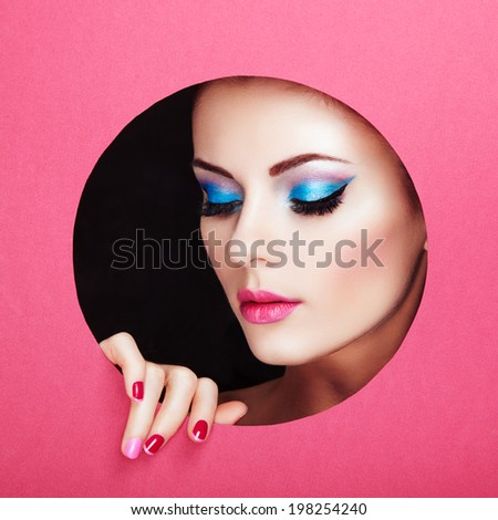 Conceptual beauty portrait of beautiful young woman. Perfect Manicure.  Cosmetic Eyeshadows. Fashion photo