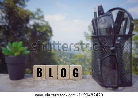 Conceptual - 'BLOG' written on wooden blocks. Blurred styled background.