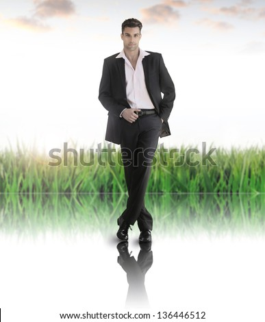 Conceptual business portrait of a handsome fit male model in abstract modern set