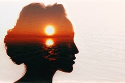 Conceptual codependency double exposure. Sunrise in the woman head.