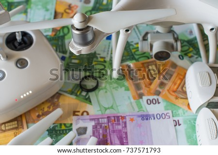 Conceptual composition. Accessory for a drone in the background of Euro banknotes. Selective focus. #737571793