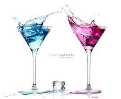 Conceptual Elegant Martini Glasses with Splashing Colored Cocktails with Ice Cube on the Table. Isolated on White Background with Copy Space at the Center. Template design with Sample Text