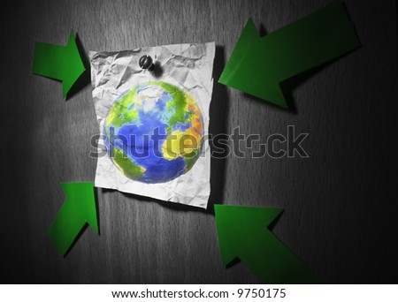 Conceptual environment image. Earth pined to wall on a crumpled paper and pointed by green arrows.Some graphics in this montage provided by NASA (http://visibleearth.nasa.gov/)