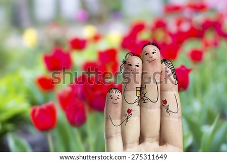 Conceptual family finger art Father son and daughter are celebrating their mother's day Happy Mother's Day birthday and 8 March creative and funny love series Painted fingers family concept