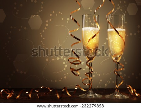 Conceptual Golden Brown Wine on Elegant Glass with Spiral Thin Wrapping Foils or Laces Decoration, on Abstract Brown Background.